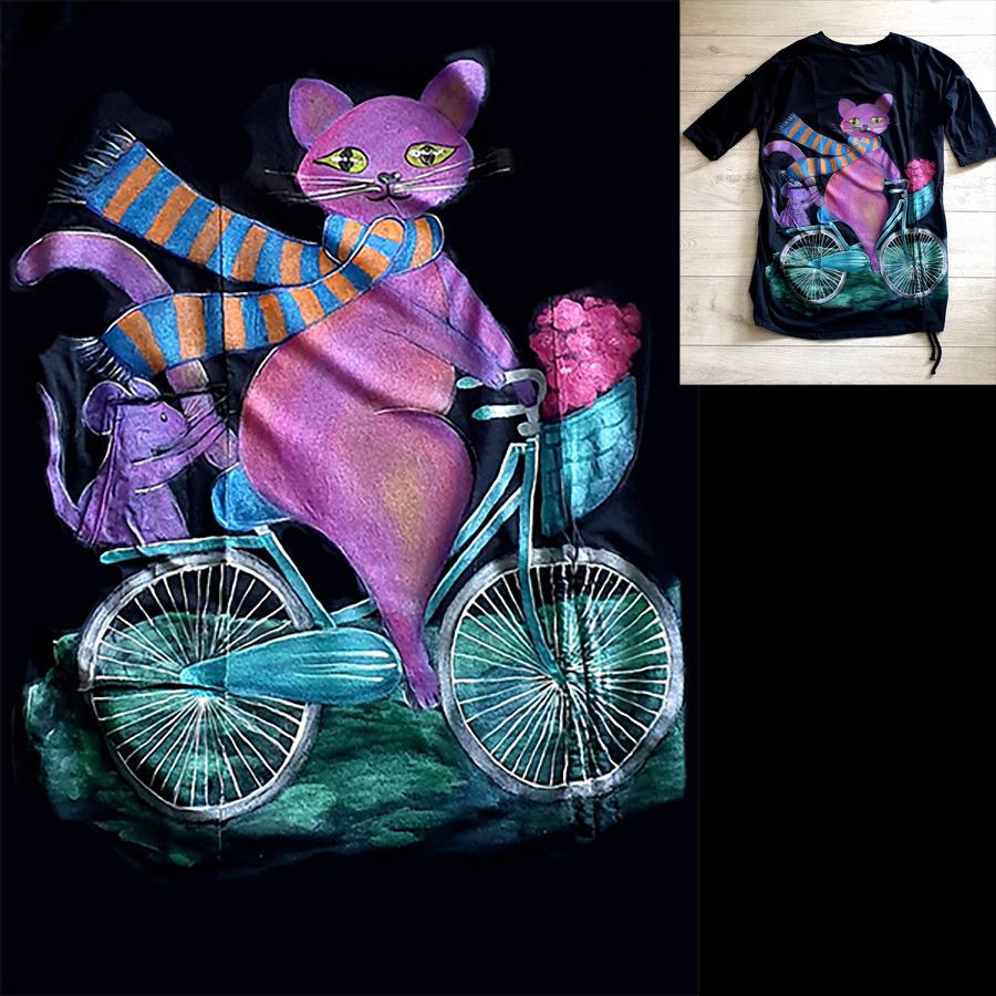 Motivi in poslikave muce na kolesu z miško v košari.