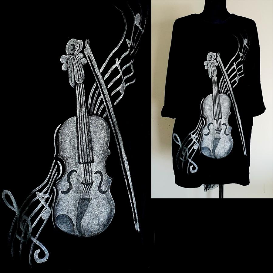 Motiv violine z lokom in notami v ozadju.