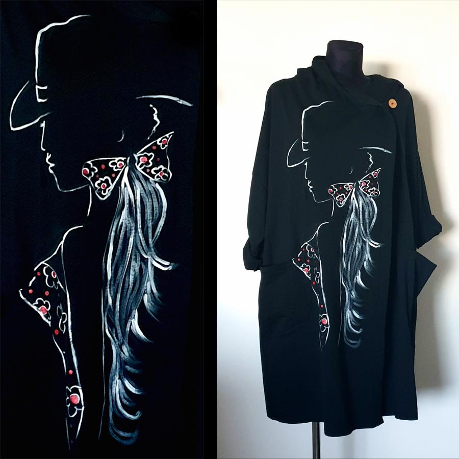 Dama v obrisih z belo barvo in črna obleka.