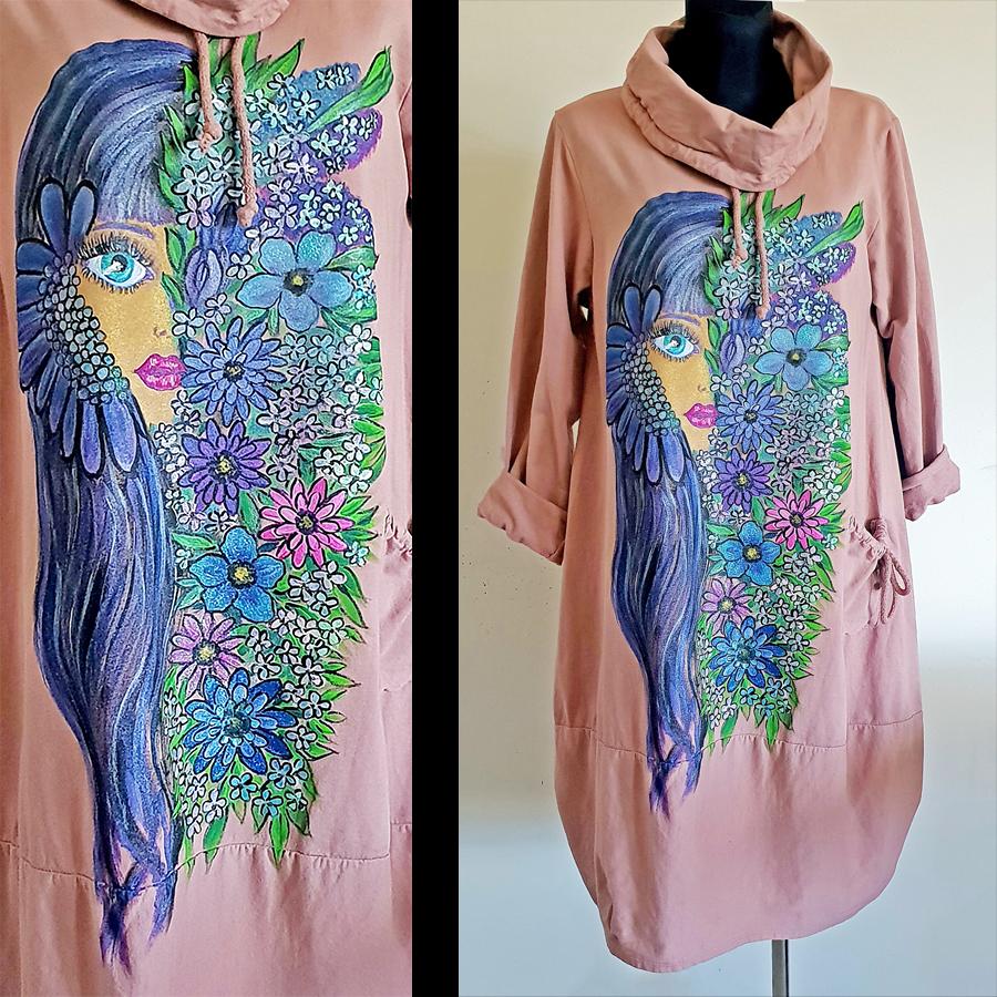 Dama z barvnimi rožami na roza obleki