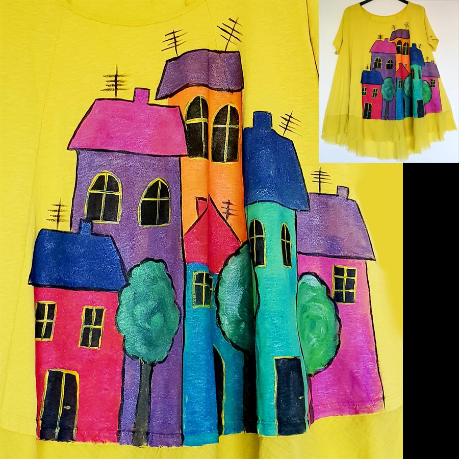 Motivi in poslikave Hiše 3 s pisanimi hišami kot pravljično mesto.