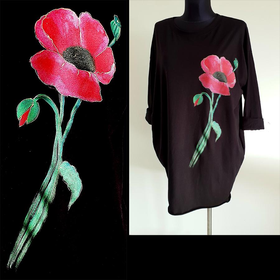 Motiv in poslikave rdeč makov cvet s popkom in steblom na črni obleki.