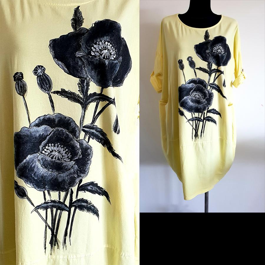 Motivi in poslikave makov v črno beli izvedbi na svetlo rumeni obleki.