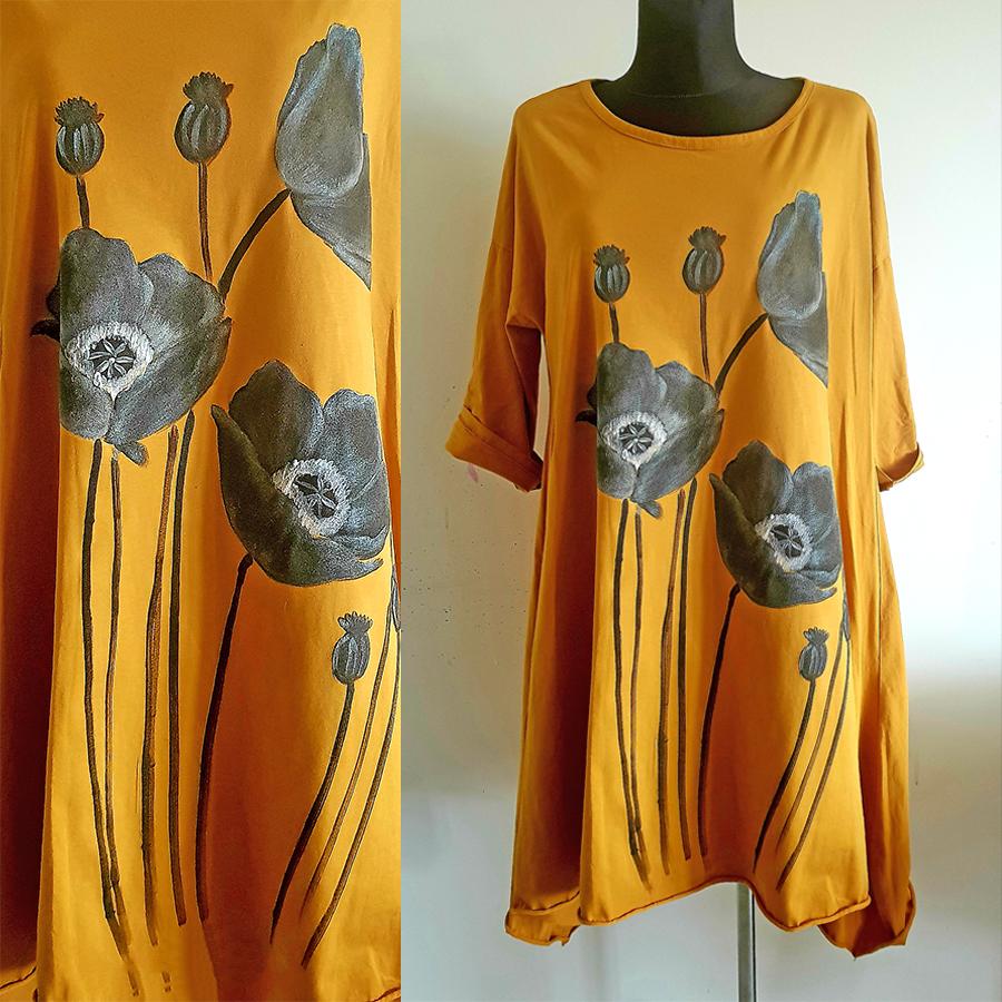 Maki cvetovi na oranžni obleki